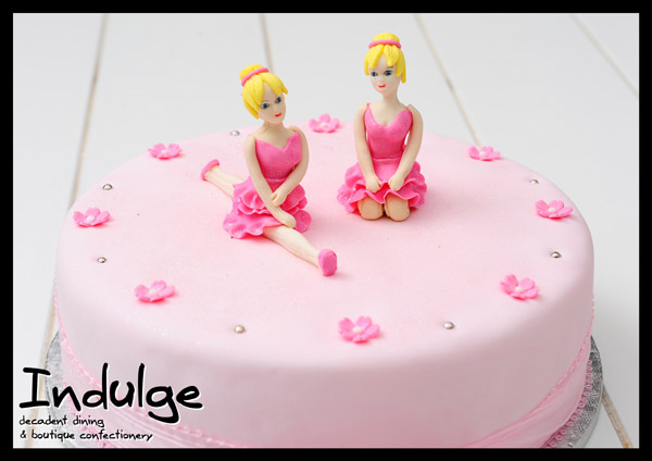 ballerina childrens sponge cake with sugar paste icing and decorated with edible figurines