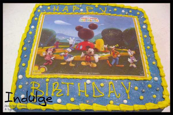 mickey mouse edible image cake childrens sponge cake with sugar paste icing and decorated with edible figurines